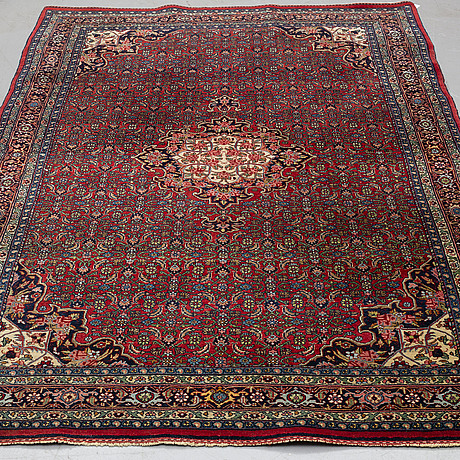 A rug, an old bidjar, ca 226 x 144,5-150,5 cm (as well as 1 cm flat weave at the ends).