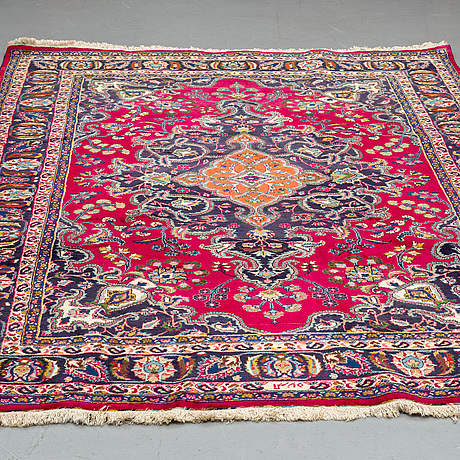 A carpet, old mashad, ca 299 x 206 cm.