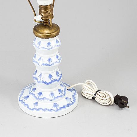 Wilhelm kÅge, a creamware table lamp, gustavsberg, sweden, dated 1920.