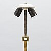 Paavo tynell, a mid-20th century floor lamp for taito, finland.
