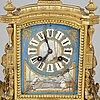 A late 19th century bronze and porelain mantel clock.