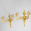A 20th century pair of louis xvi style wall sconces.