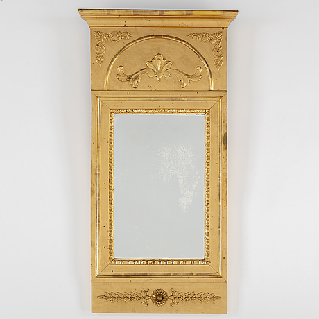 A gilt and bronzed empire style mirror from around 1900.