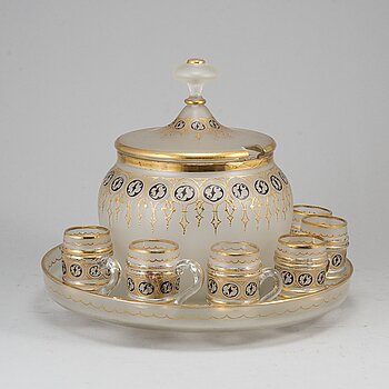 A glass punch bowl with eight jugs and turning dish, mid 19th century.
