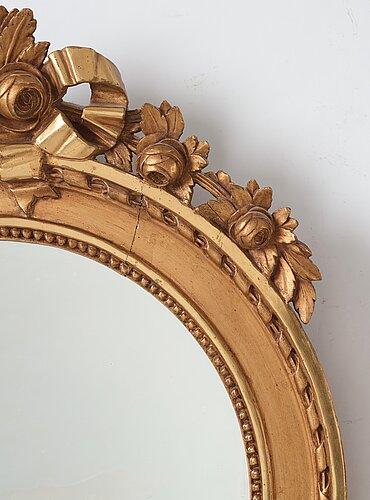 A gustavian two-light girandole mirror.
