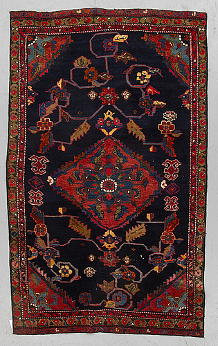 A rug, semi-antique kurdish, ca 194 x 112 cm.
