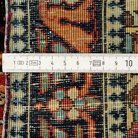 A rug, a semi-antique kashan motachem, ca 84 x 64 cm.