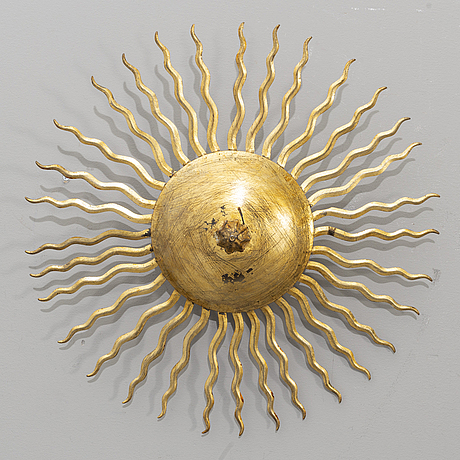 A ceiling lamp in the shape of the sun. mid 20th century.
