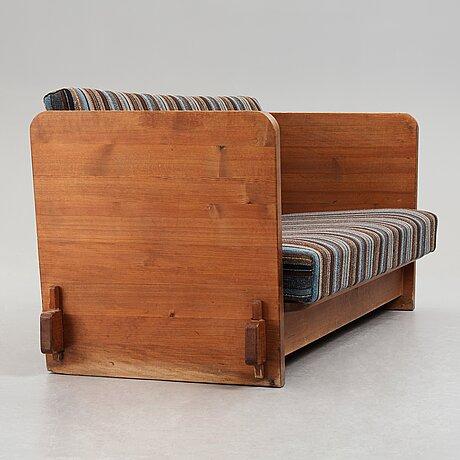 "Axel einar hjorth, a stained pine ""lovö"" sofa, nordiska kompaniet, sweden 1930's."
