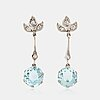 A pair of 18k white gold earrings set with faceted aquamarines and eight-cut diamonds.