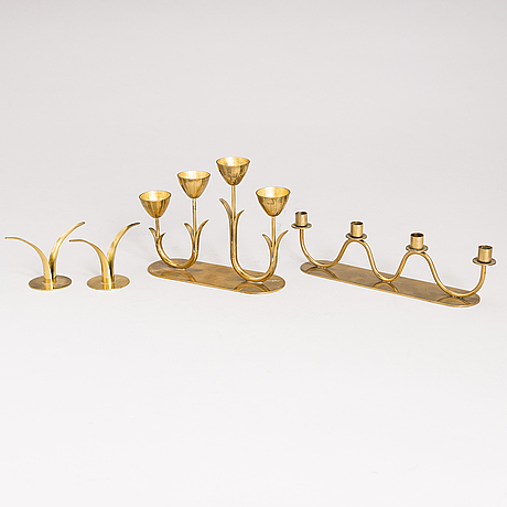 A pair of candlesticks, designed by ivar Ålenius-björk and two candlesticks by gunnar ander. brass.