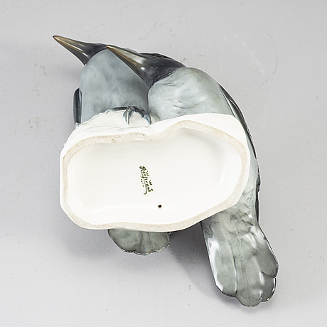 An early 20th century porcelain figurine.