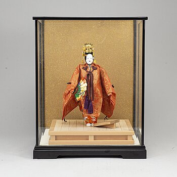 A Japanese doll from the 20th century.