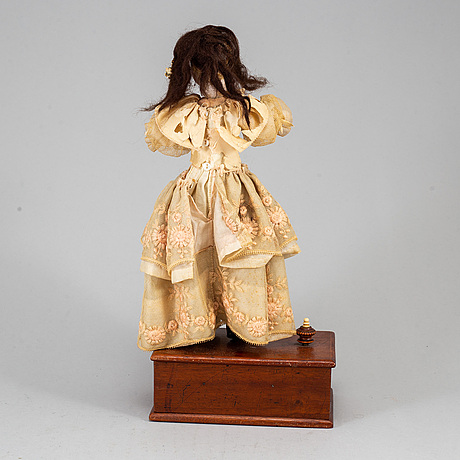 A bisquit doll with musicbox, circa 1900.