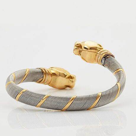 "A cartier ""panthère"" bracelet in steel and 18k gold."