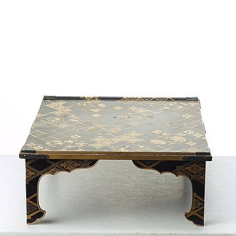 A japanese lacquered bundai table, meiji period (1868-1912). signed.