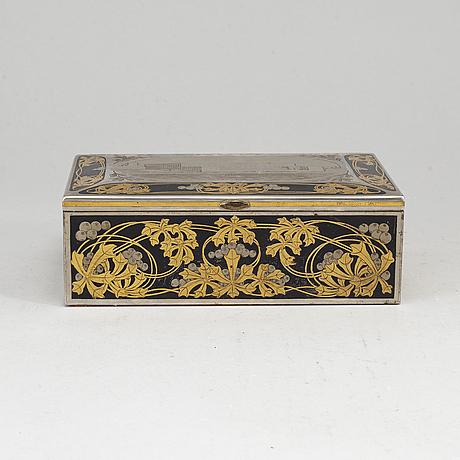 A steel and brass cigarr box by emil olsson eskilstuna around 1900.