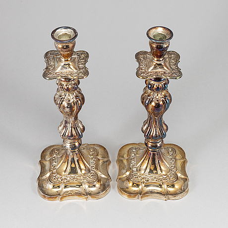 A pair of silver plated candlesticks.