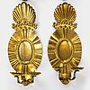 A set of four baroque style brass wall sconces, probably 1950s.