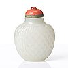 A neprite snuff bottle with stopper, qing dynasty, 19th century.