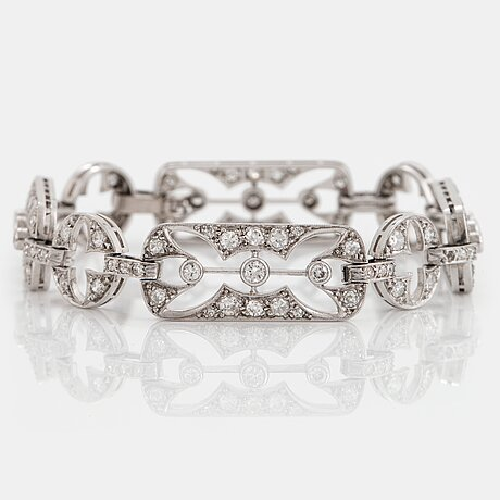 A platinum bracelet set with old- and eight-cut diamonds.
