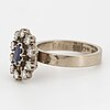 Oval faceted sapphire and brilliant-cut diamond ring.