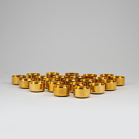 Pierre forssell, 22 gilt brass tumblers from skultuna.