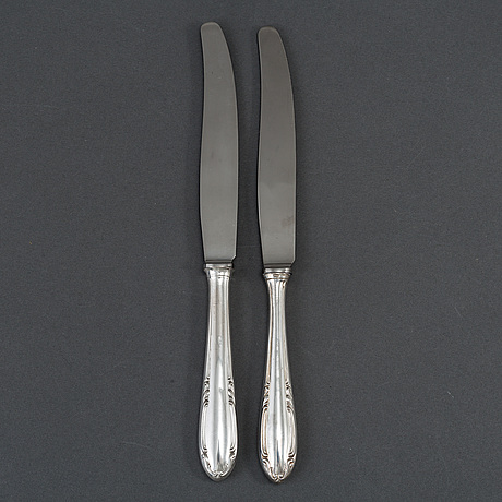 "12 silver knives, model ""slottsbarock"". some cg hallberg, stockholm 1946."