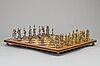 Chess board, with silver and silver gilt chess pieces.