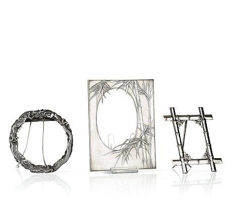 A set of three silver frames, japan and china, early 20th century. the large one marked miyamoto shoko, tokyo.