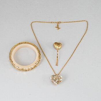LOUIS VUITTON, a bangle, a necklace and a hairpin.