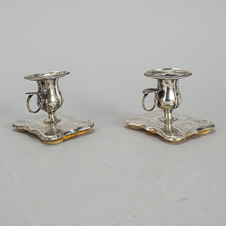 A pair of finnish 19th century silver candleholders.
