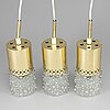 Three brass and glass pendant lights, 1960's.