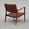 A 1950/60's teak armchair by karl -erik ekselius.