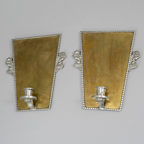 A pair of wall sconces by cg hallebrg dated 1929.