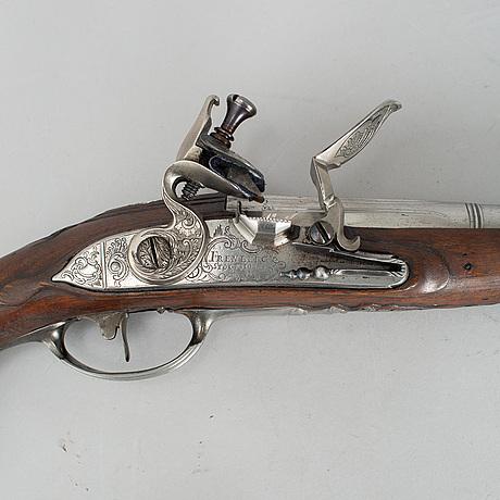 A 1750's pair of flintlock pistols by olof frenberg, stockholm.