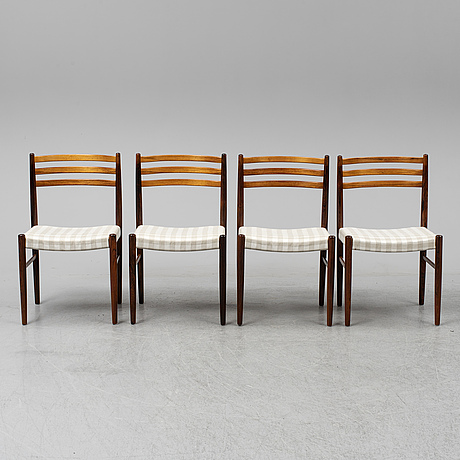 A danish mid 20th century rosewood dining table and four chairs.