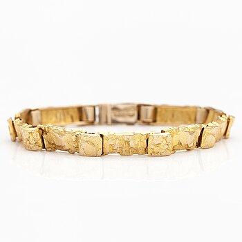 """BJÖRN WECKSTRÖM, A 14K gold bracelet """"Jotos"""". Lapponia 1971."""