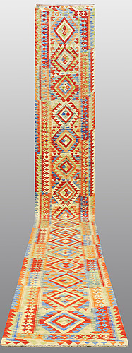 A runner, kilim, 610 x 85 cm.