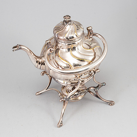 A silver plate teapot on rechaud, three parts.