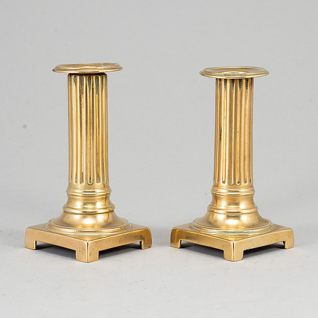 A pair of louis seize bronze candlesticks, late 18th century.