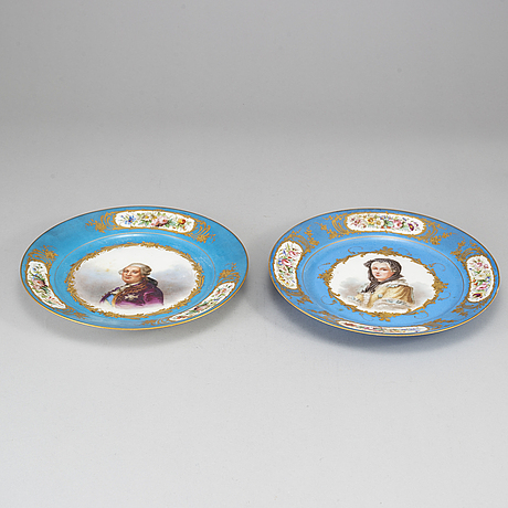 A pair of french porcelain plate, one with sevrès like mark, early 20th century.