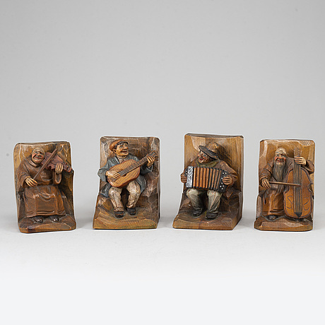 Two pairs of carved wood book ends, 20th century.