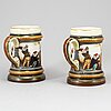A pair of majolica tankards, rörstrand, early 20th century.