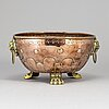 A 19th century copper and brass flower pot.