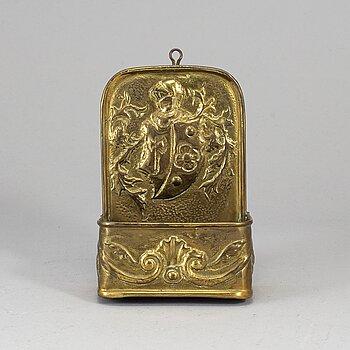 A 19th century brass spoon holder.