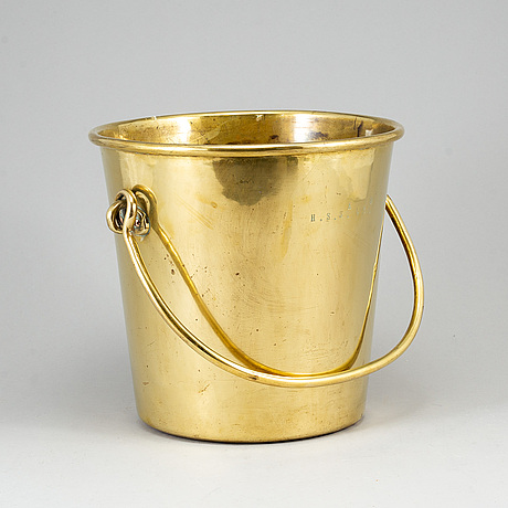 A 19th century bronze champagne cooler.