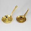 Two 18th century brass night light holders.