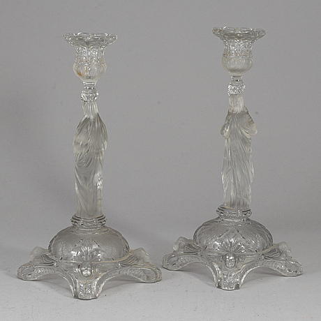 A pair of moulded glass candlesticks,  ca 1900.