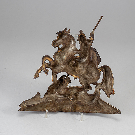 A 19th century iron decorative piece.